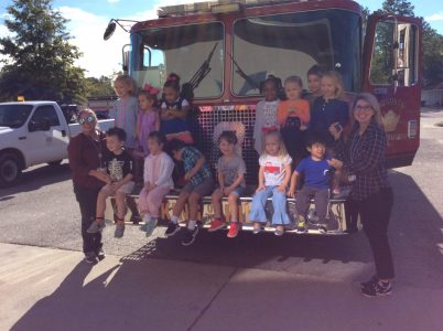 Episcopal Day School (EDS) students on a firetruck.